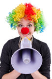 Businesswoman clown with loudspeaker isolated Stock Photo