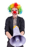 Businesswoman clown with loudspeaker isolated Royalty Free Stock Photography