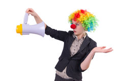 Businesswoman clown with loudspeaker isolated Stock Photography