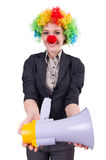 Businesswoman clown with loudspeaker isolated Royalty Free Stock Images