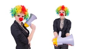 The businesswoman clown with loudspeaker isolated on white Royalty Free Stock Photos