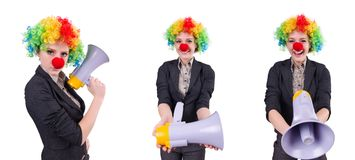 The businesswoman clown with loudspeaker isolated on white Stock Photos