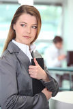Businesswoman clutching important document Stock Photo