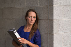 Businesswoman clutching an office binder Stock Photo