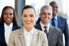 Businesswoman with co-workers Royalty Free Stock Photos