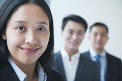 Businesswoman with co-workers portrait Royalty Free Stock Photos
