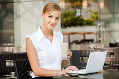 Businesswoman With Coffee & Laptop Royalty Free Stock Photo