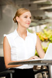 Businesswoman With Coffee & Laptop Royalty Free Stock Photography