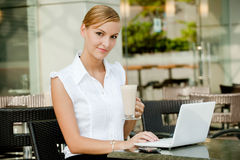 Businesswoman With Coffee & Laptop Royalty Free Stock Image
