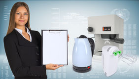 Businesswoman with coffee machine, kettle and Stock Photo