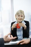 Businesswoman with coffee mug Royalty Free Stock Images
