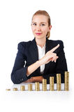 Businesswoman with coins Stock Images