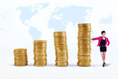 Businesswoman and coins chart Royalty Free Stock Images