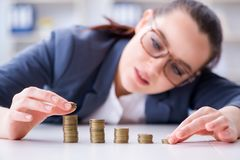 The businesswoman with coins in forex concept. Businesswoman with coins in forex concept Stock Photos