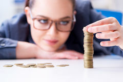 The businesswoman with coins in forex concept Stock Photo