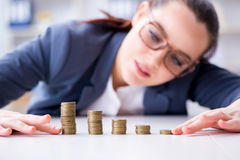The businesswoman with coins in forex concept. Businesswoman with coins in forex concept Royalty Free Stock Images