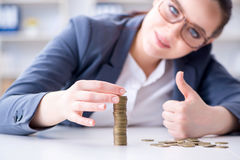The businesswoman with coins in forex concept Royalty Free Stock Photos