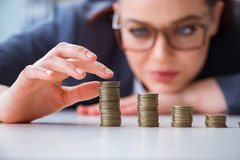 The businesswoman with coins in forex concept Stock Photography