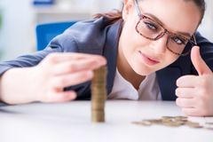 The businesswoman with coins in forex concept Royalty Free Stock Images