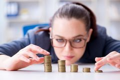 The businesswoman with coins in forex concept Royalty Free Stock Photo