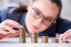 The businesswoman with coins in forex concept. Businesswoman with coins in forex concept Royalty Free Stock Image