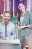 Businesswoman and colleague in office Stock Photos