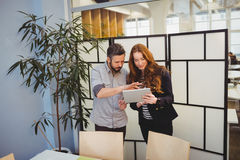 Businesswoman with colleague using digital tablet Stock Photo