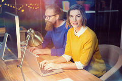 Businesswoman and colleague working at desk. In office Royalty Free Stock Photography