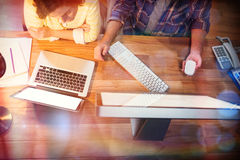 Businesswoman and colleague working at desk. In office Royalty Free Stock Images