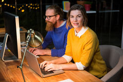 Businesswoman and colleague working on at their desk Stock Images