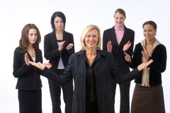 Businesswoman and colleagues. Business woman is presenting her successful business team, which is applauding Stock Photography