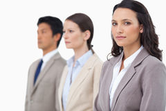 Businesswoman with colleagues next to her Royalty Free Stock Images