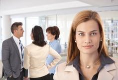 Businesswoman with colleagues at office Royalty Free Stock Photo
