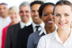 Businesswoman with colleagues. Smiling businesswoman with colleagues standing in a row stock photography