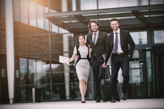 Businesswoman with colleagues walking Royalty Free Stock Photos