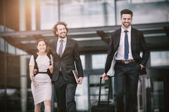 Businesswoman with colleagues walking Stock Photo