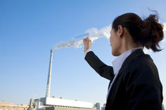 Businesswoman Collecting Smoke in Beaker Stock Photography
