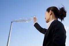 Businesswoman Collecting Smoke in Beaker Royalty Free Stock Photo