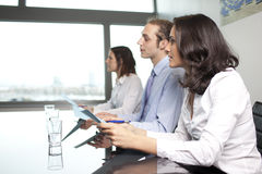 Businesswoman with collegues Stock Images