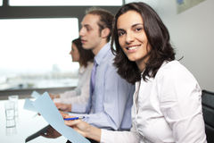 Businesswoman with collegues Stock Image