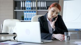 Businesswoman comes at her desk takes her phone starts typing and talking stock video