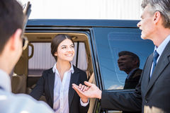 Businesswoman coming out of a car Royalty Free Stock Photography