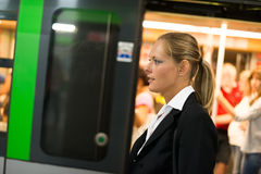 Businesswoman coming out from the subway train Royalty Free Stock Image