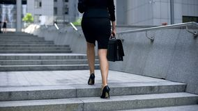 Businesswoman coming upstairs to office center, going to work, busy lifestyle royalty free stock images