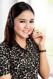 Businesswoman communicate by wireless headset Stock Photography