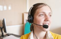 Businesswoman communicating on headset Stock Images