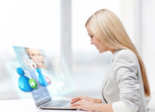 Businesswoman communicating with helpline operator Stock Images