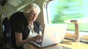 Businesswoman Commuting To Work On Train And Using Laptop stock video