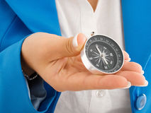 Businesswoman with compass Stock Images