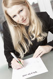 Businesswoman completes contract Royalty Free Stock Photos